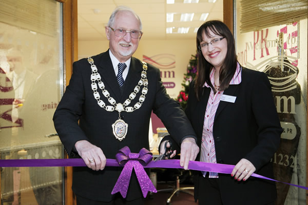 The Mayor of Weston-super-Mare, Cllr Keith Morris and Karen Morledge, managing director of Plum Communications & PR, cutting the ribbon.